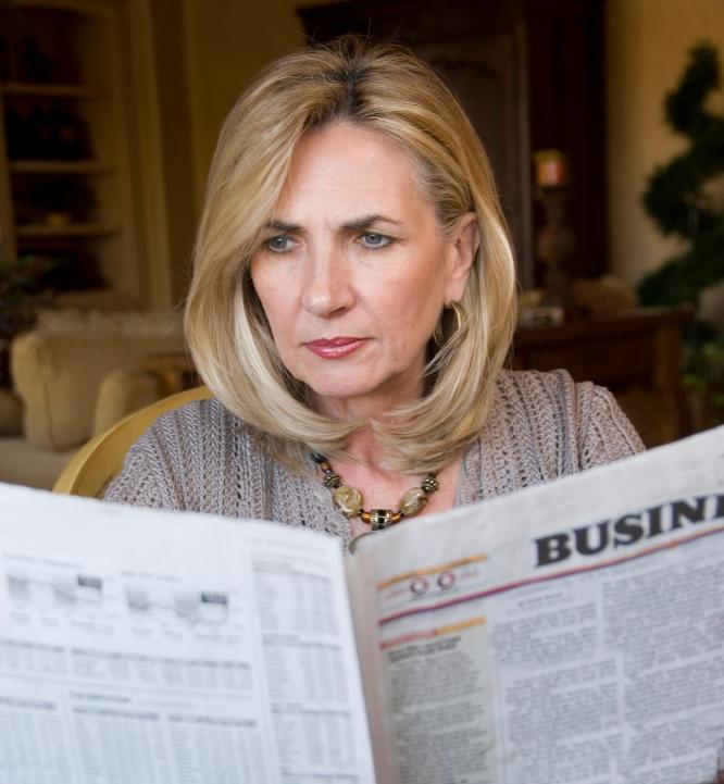 Newspaper reader female